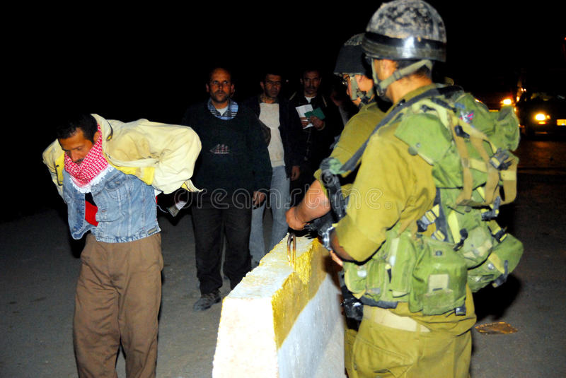 Israeli checkpoint. WEST BANK, ISR - MAR 05:Israeli soldiers checks Palestinians on Mar 5, 2008.Since the 90s Israel has created hundreds of permanent roadblocks stock photos