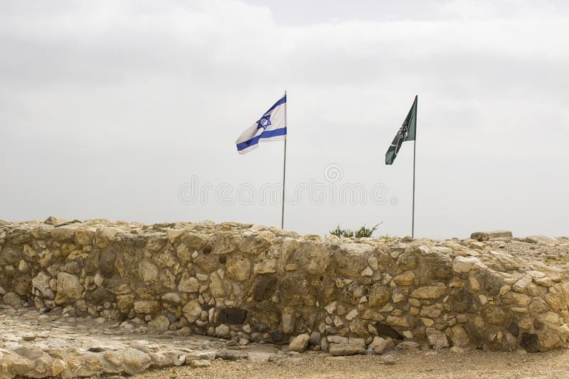 Israeli Flag aloft atTel Megiddo archaeological site Israel. An sraeli Flag aloft at the top of the famous Tel Megiddo archaeological site Israel. This is the royalty free stock photography
