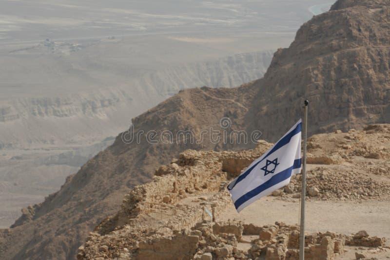 Israeli Flag on a Desert Mountain(Masada) royalty free stock photography