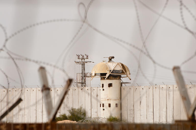 Israeli Gun Tower on Gaza Border Wall. EREZ CHECKPOINT, OCCUPIED PALESTINIAN TERRITORIES - JANUARY 17: An Israeli military remote-controlled sniper gun is royalty free stock images
