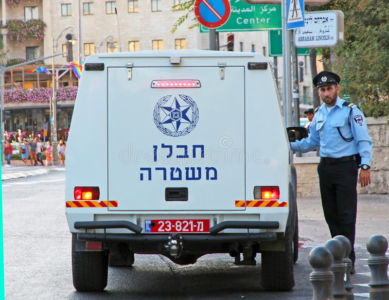 Israeli Police Bomb Squad Vehicle. With a policeman standing next to it. parking in a street in Jerusalem, Israel stock image