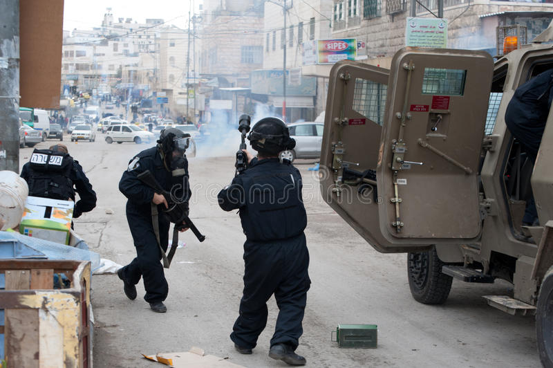 Israeli soldiers fire tear gas royalty free stock photo