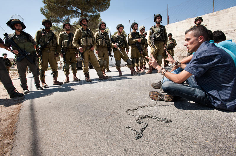 Israeli soldiers and Palestinian protest stock image
