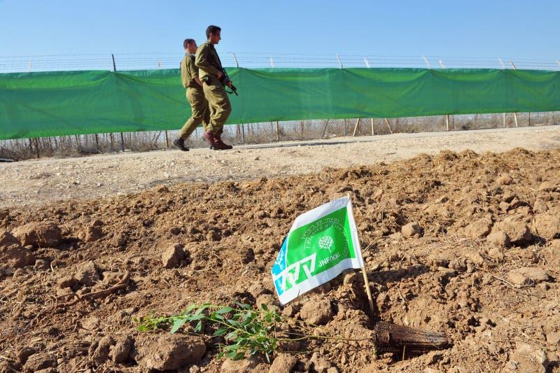 Israelis Celebrate Jewish Holiday of Tu Bishvat. WESTERN NEGEV - JAN 20 201:Israeli soldiers plants Keren Kayemet LeIsrael KKL tree in Tu Bishvat.It's a Jewish stock photos