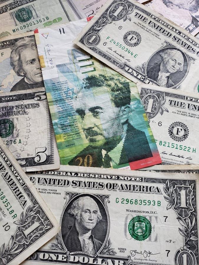 israelische Banknote von Schekel 20 und amerikanischen von Dollarscheinen lizenzfreies stockbild