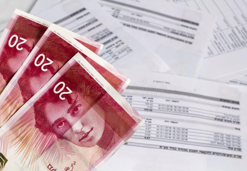 Israelische neue Schekelbanknoten auf dem Rechnungs-Hintergrund lizenzfreies stockbild