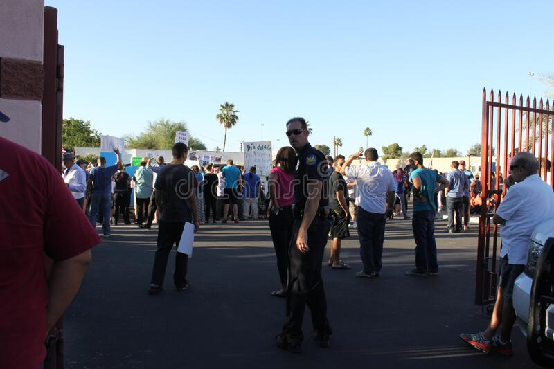 """Isscp protest 4960. Phoenix, Ariz. / US - May 29, 2015: Police, some in riot gear, monitor armed protestors holding """"Muhammad Cartoon Contest` and counter stock images"""