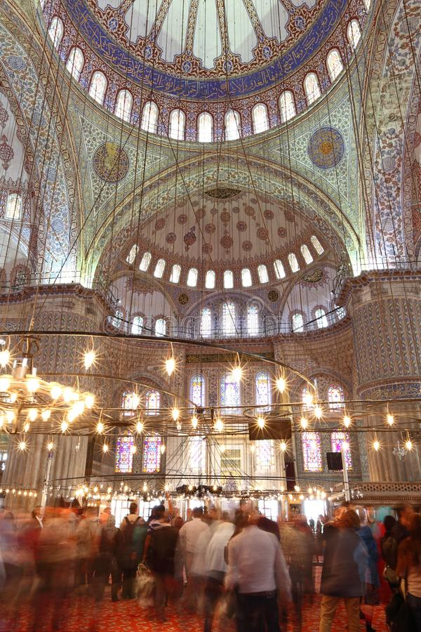 Istanbul Blue Mosque. Inside the mosque with the tourists blurred due to long exposure stock photos