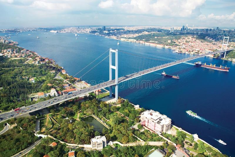 Istanbul Bosphorus Bridge. And ferry on the sea royalty free stock photo