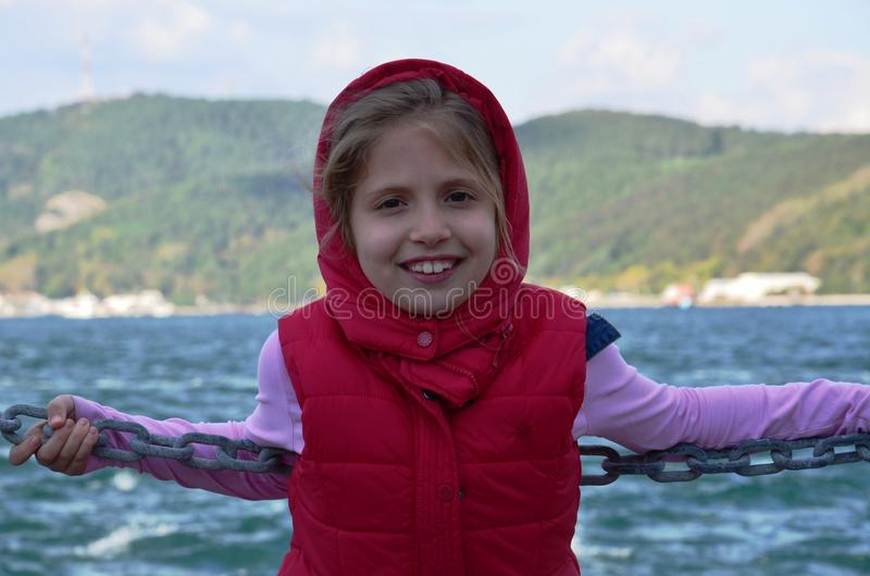 Istanbul Bosphorus cool waters of the blonde girl in front of the cold stock photography