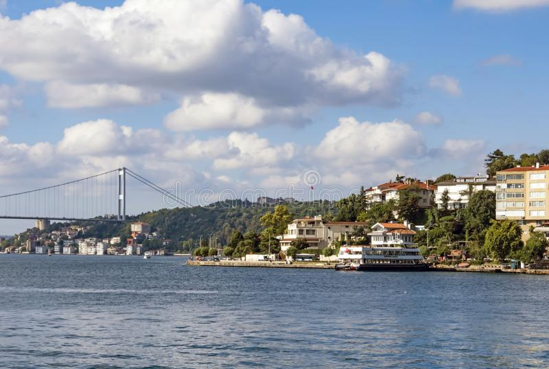Istanbul,Bosporus gives you a wonderful nature and city view with bridge and modern, historical build stock photos