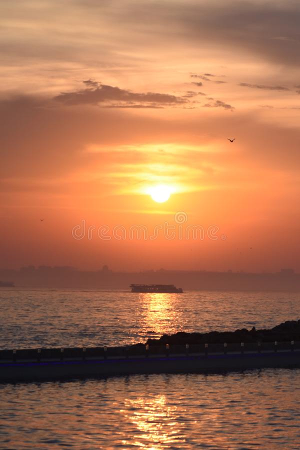Istanbul the capital of Turkey, eastern tourist city.Sunset. Istanbul the capital of Turkey, eastern tourist city. beach scene cruise turkey tower mediaeval royalty free stock photos