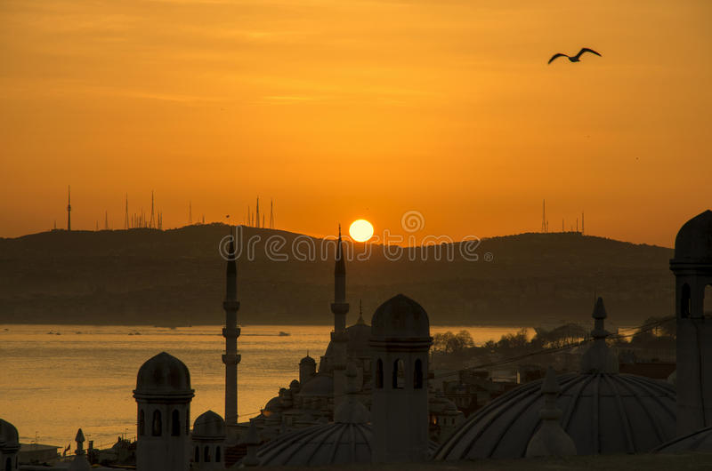 Istanbul city day is dawning. Sun's first moment he was born, the Muslim mosque minaret looks over, a new day is dawning in the morning light royalty free stock photo