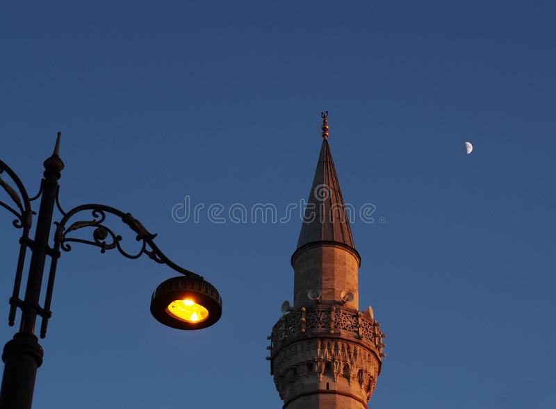 Istanbul city Mosque minaret and moon night street photo. Istanbul city, Mosque minaret night sтреет landscape and moon stock photo