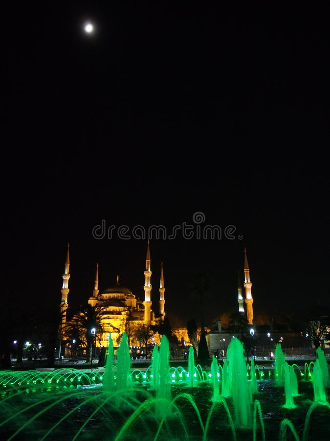 Istanbul city Sultan Ahmed Mosque and moon night street photo. Istanbul city, Sultan Ahmed Mosque night sтреет landscape and moon royalty free stock photography