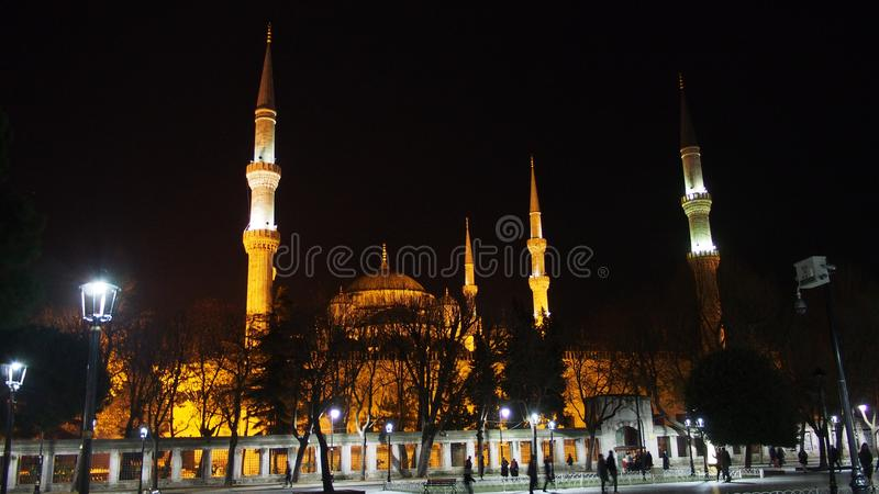 Istanbul city sultan Ahmet mosque and minarets night street photo. Istanbul city, Sultan Ahmet Mosque minarets night sтрееt landscape and facade stock image