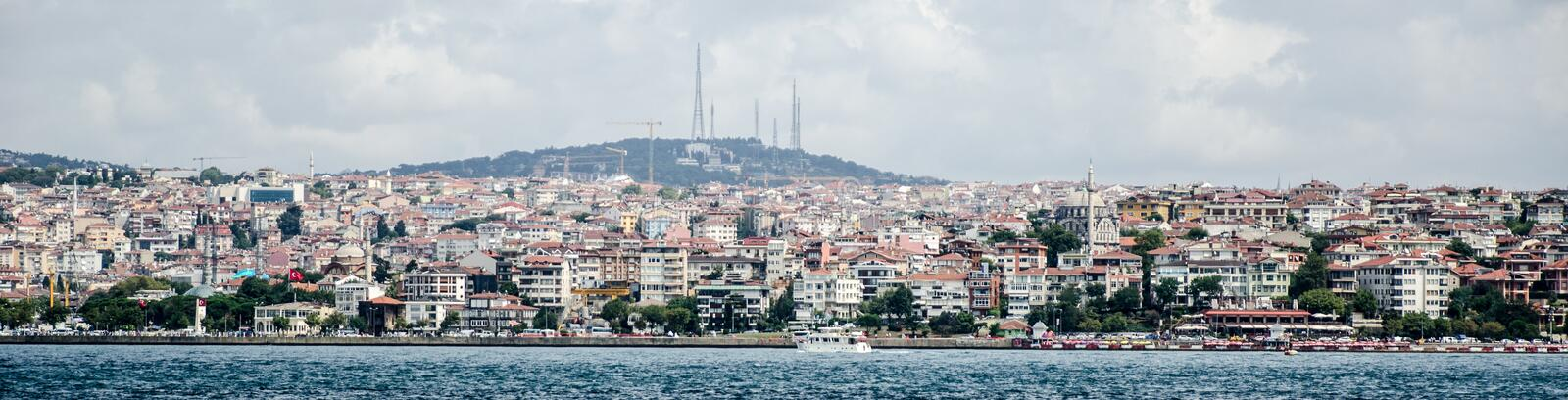 Istanbul cityscape. Istanbul city scape along the river Bosphorus with radio towers in background royalty free stock photography