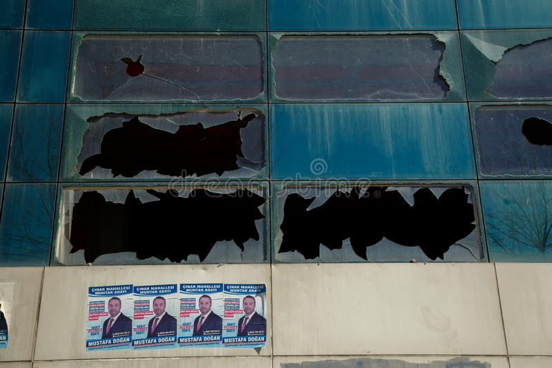 Istanbul,Esenyurt/Turkey-03.19.2019:leaflets about elections on the walls of an abandoned building with broken windows stock photos