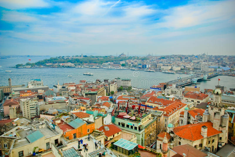 Istanbul and Galata bridge. Red and orange roofs of Istanbul and Galata bridge in the distance royalty free stock photos