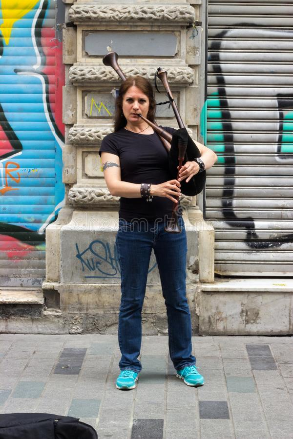 Istanbul, Istiklal Street / Turkey 15.5.2019: Street Musician Performing Bagpipe in the Istiklal Street stock photography