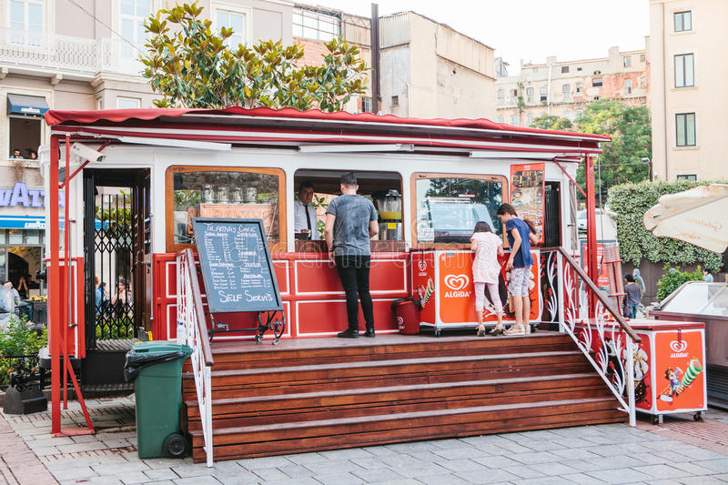 Istanbul, June 15, 2017: Popular among tourists and local people is a cafe in the form of a tram in the square next to. The Galata Tower. Turkey royalty free stock photos