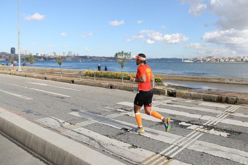 38. Istanbul Marathon. ISTANBUL, TURKEY - NOVEMBER 13, 2016: Athlete running in 38. Istanbul marathon which includes two continents in one race. Marathon starts stock photo