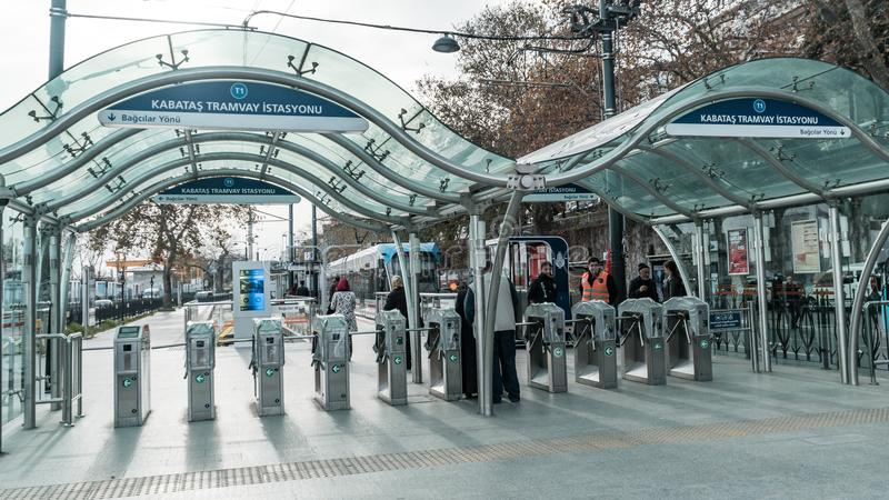 Istanbul metro entrance at Kabatas station with people going for the tramway. Istanbul, Turkey - December 2017: Istanbul metro entrance at Kabatas station with royalty free stock photos