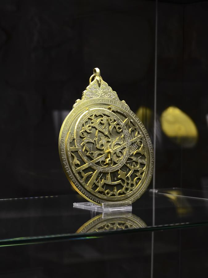 Istanbul, TURKEY, September 20, 2018. Ancient Arab bronze astrolabe. Museum of The History of Science and Technology in Islam royalty free stock image