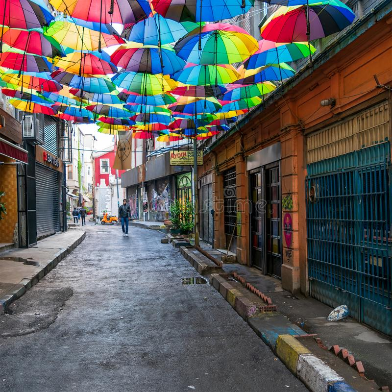 Hoca Tahsin Street at Karakoy district, Istanbul, Turkey, decorated with colorful umbrellas. Istanbul, Turkey - April 18, 2017: Hoca Tahsin Street at Karakoy royalty free stock image