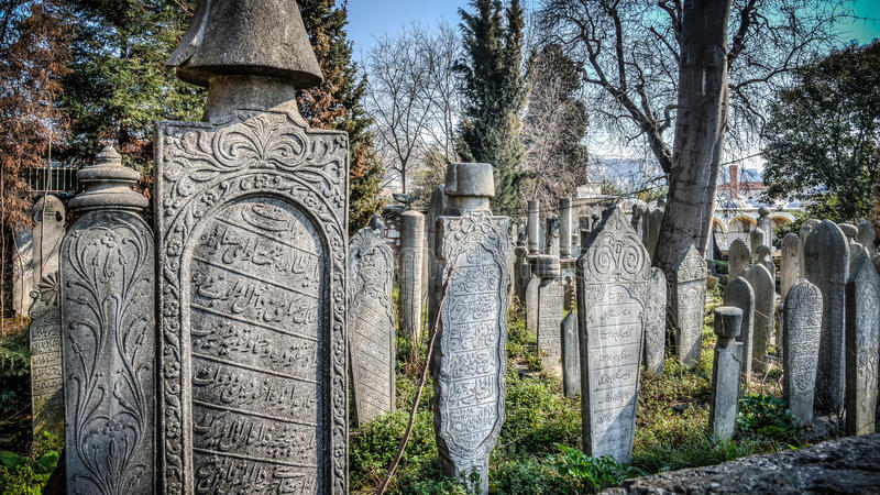 Istanbul, Turkey - April 05, 2014: The ottoman sultan historic old tombstone in the Eyup cemetery, Istanbul, Turkey stock images