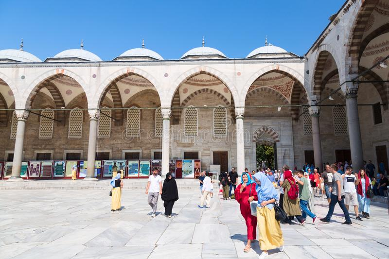 Istanbul, Turkey - August, 2018: Courtyard of Blue mosque with people in Sultanahmet park in Istanbul, Turkey. The biggest and. Most famous mosque in Istanbul stock photography