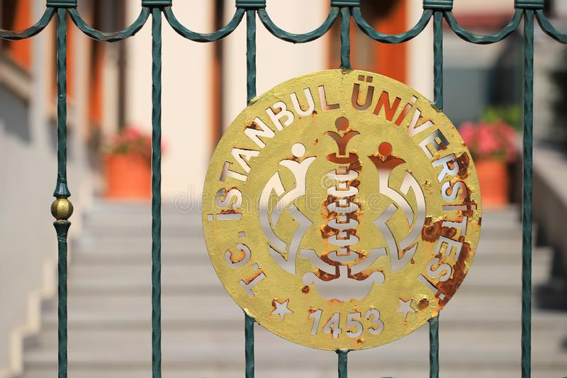 ISTANBUL, TURKEY - AUGUST 26, 2019: Logo Istanbul university. Close up on the fence stock photo