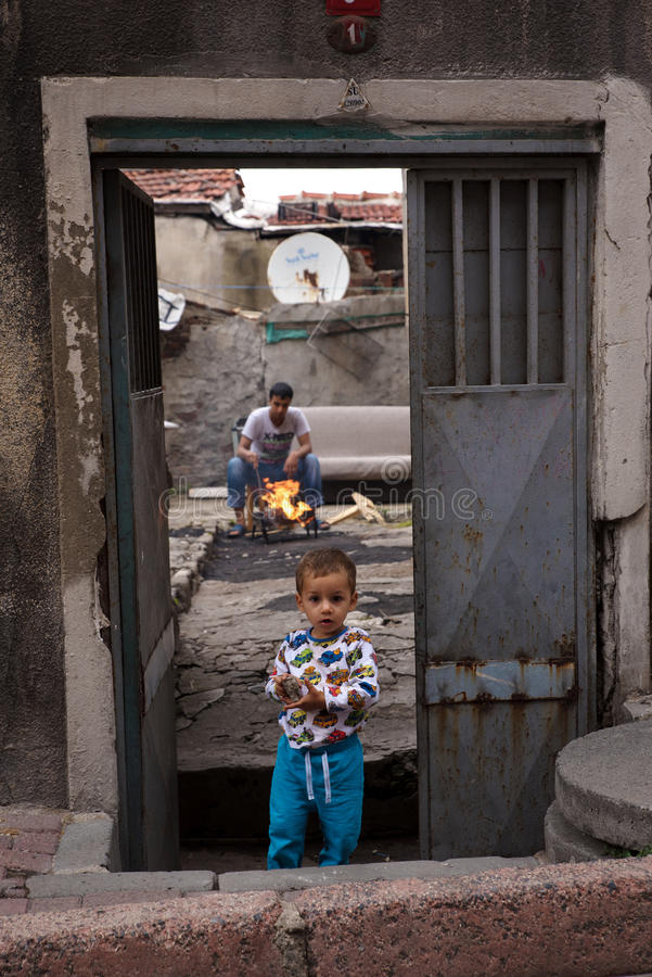 Istanbul, Turkey - August 23, 2015: Syrian refugees in Istanbul, Turkey. Syrian refugees in Istanbul, Turkey. Little boy standing in front of a ruined house and stock photography