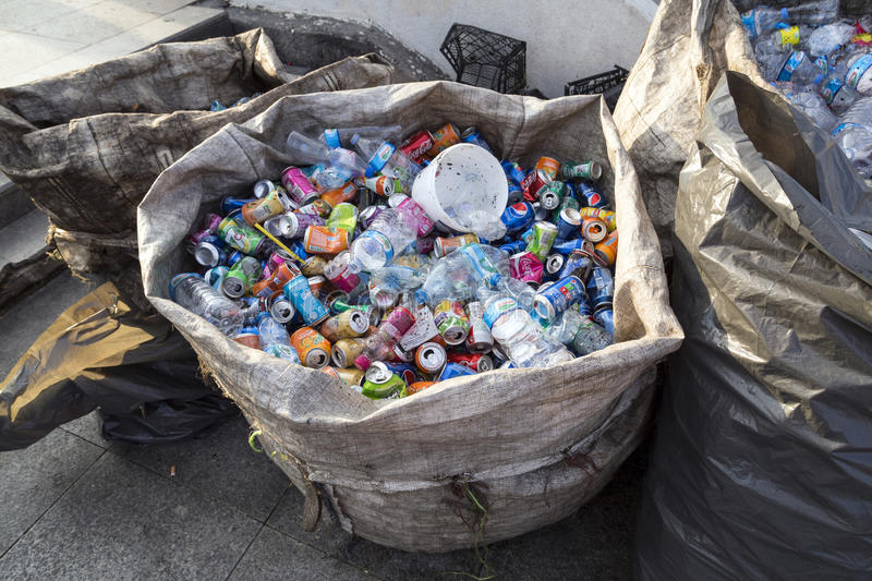 ISTANBUL, TURKEY - August 23, 2015: Used crushed beverage cans. And plastic bottles in plastic garbage bags for recycling include popular brands,Istanbul,Turkey stock images
