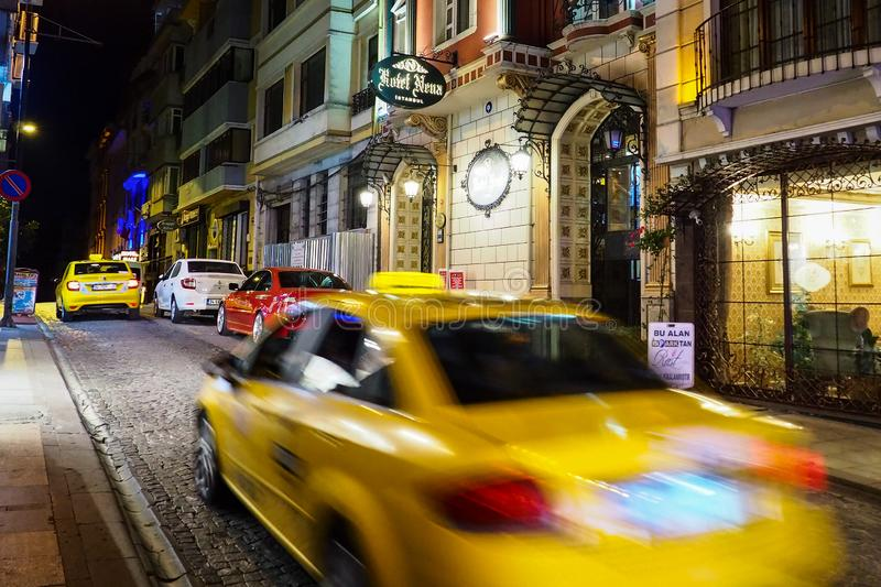 ISTANBUL, TURKEY - AUGUST 21, 2018: yellow taxi cab in motion blur stock photography
