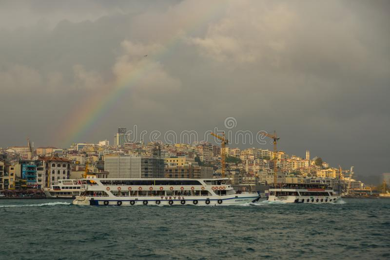 Istanbul, Turkey: Beautiful views of the sea, houses, cranes and rainbow royalty free stock photos