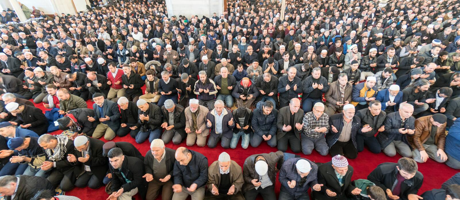 Friday prayer is a prayer performed once a week by Muslims. ISTANBUL, TURKEY - DEC 8: Friday pray in congregation male Muslims Fatih Mosque on December 8, 2017 stock photos