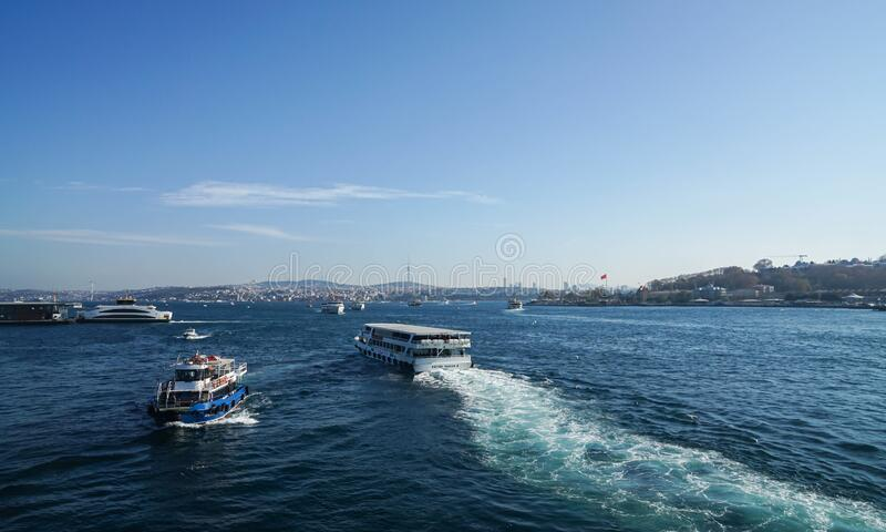 Istanbul / Turkey - December 9 2019: cruise and boat tour in Bosphorus Black Sea in blue sky sunny day royalty free stock images