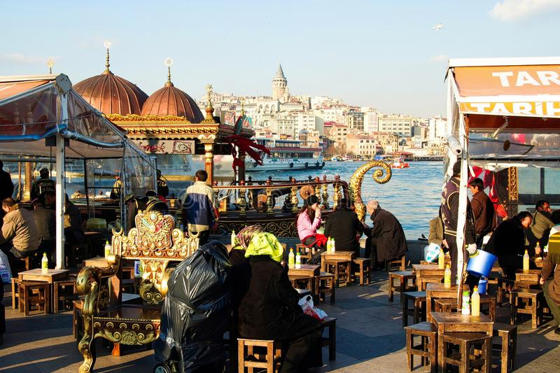 ISTANBUL, TURKEY - FEBRUARY 24. 2009: View from market with chairs and tables over Bosphorus  river on asian district stock images