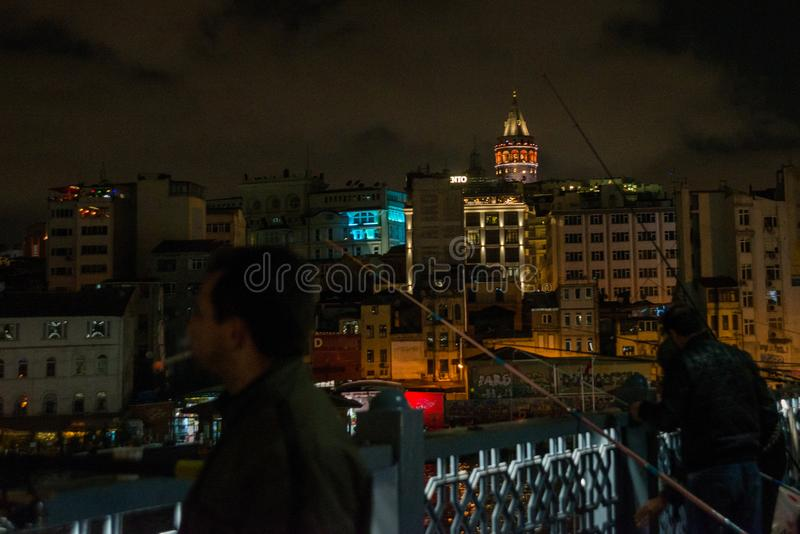 Istanbul, Turkey Fishermen on the Galata bridge. Galata or Beyoglu district of Istanbul at night, Turkey. This is one of the main. Tourist places in Istanbul stock images