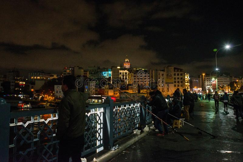 Istanbul, Turkey Fishermen on the Galata bridge. Galata or Beyoglu district of Istanbul at night, Turkey. This is one of the main. Tourist places in Istanbul stock image