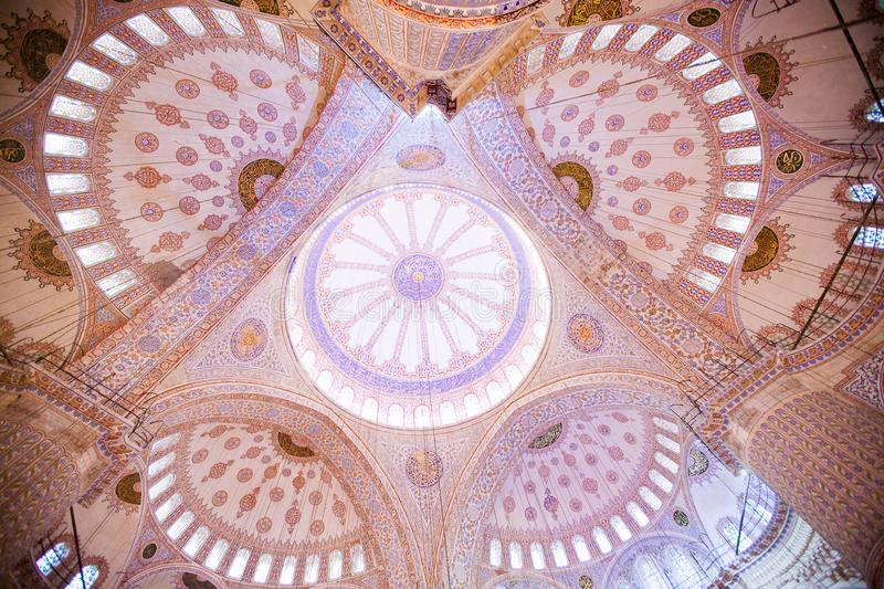 ISTANBUL, TURKEY - JAN 13, 2018: Interior of the Sultanahmet Mos. Que Blue Mosque in Istanbul, Turkey royalty free stock photo