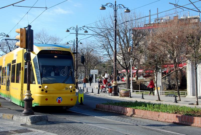 Long yellow tram. ISTANBUL, TURKEY - JAN 16, 2013 - Long yellow tram in Istanbul, Turkey stock photography