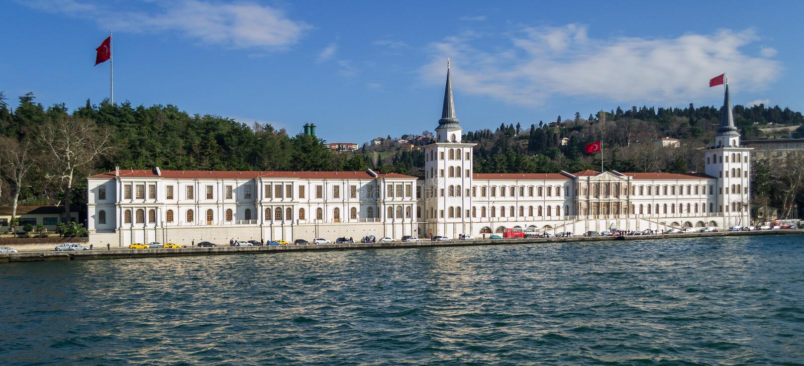Kuleli Military High School with tower and flags of Turkey on shore of Bosphorus strait, Istanbul. Istanbul, Turkey - January 20 2013: Kuleli Military High stock photography