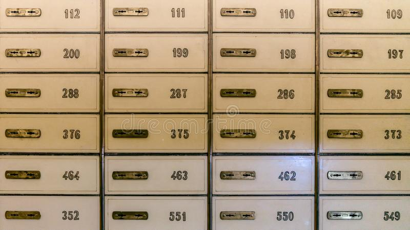 Rows of safety deposit boxes in a bank vault or security lockers. Istanbul, Turkey - January 2018: Rows of safety deposit boxes in a bank vault or security royalty free stock image