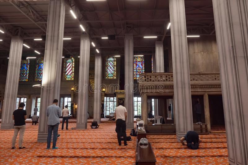 Men pray in mosque in Istanbul stock photos