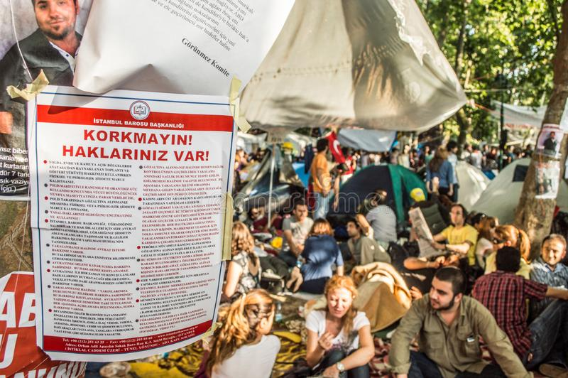 Notice of Istanbul Bar Association attached on tree during the protests against demolition of Taksim Gezi Park in Istanbul Turkey royalty free stock photography