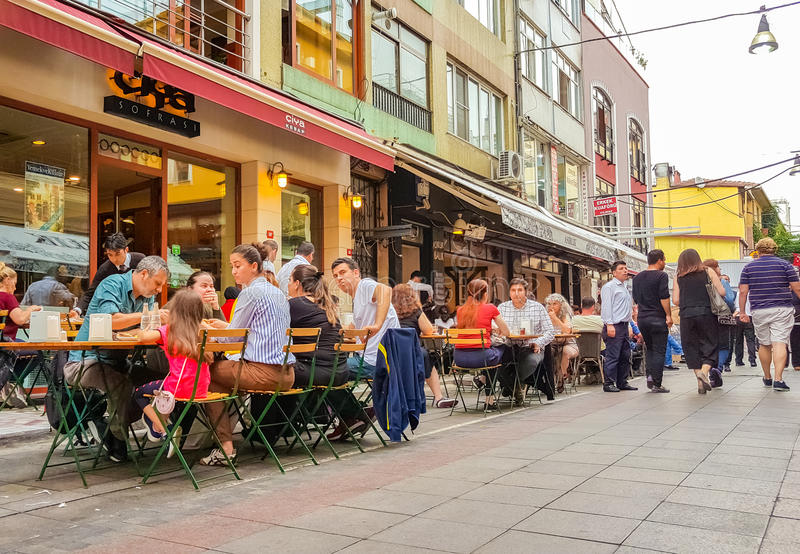 Istanbul, Turkey - June 02, 2017: People eating at the outside of touristic restaurants in old Kadikoy streets. stock photography