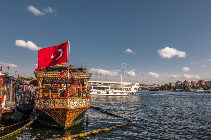 Fisnd and bread boats in Eminonu, Istanbul. Istanbul, Turkey - June 27, 2019: Traditional fish-and-bread boats along Eminonu coast on the Golden Horn against royalty free stock photos