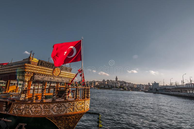 Fisnd and bread boats in Eminonu, Istanbul. Istanbul, Turkey - June 27, 2019: Traditional fish-and-bread boats along Eminonu coast on the Golden Horn against royalty free stock image